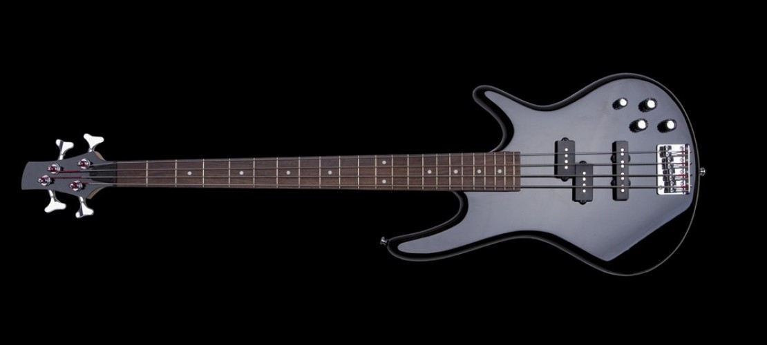 Ein Bass sieht so ähnlich aus wie eine Gitarre, hat aber nur vier Saiten. (Foto: Fotolia)