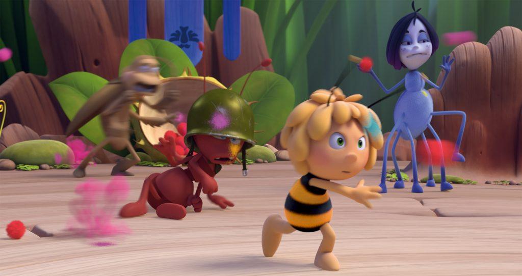 Das Foto zeigt eine Szene aus «Die Biene Maja - Die Honigspiele»: Maja und ihre Mannschaft beim Wettkampf. (Foto: Universum Film)